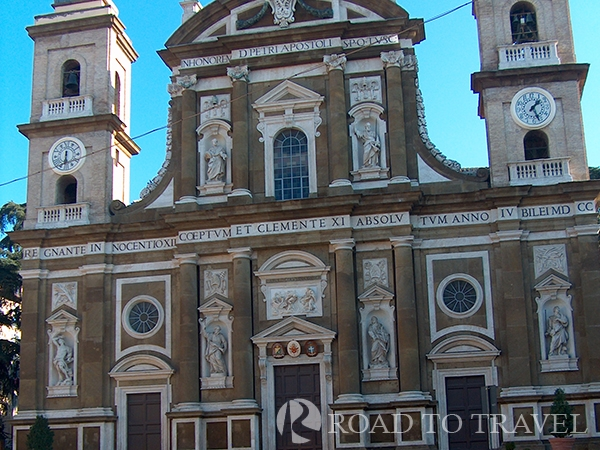 Frascati - Cathedral View of the facade of Frascati Cathedral. Dedicated to St Peter the Apostole it is one of the finest<br/>examples of Baroque churches of Rome area. Frascati has always been famous for Italians to<br/> produce an excellent Frascati DOC white wine and for its historical cellars, where once it was <br/>common to go and buy the fresh wine tapped directly from the barrels. Today the wineries have<br/>become nice small restaurants thet offer local specialties accompanied by a carafe of fresh wine <br/>tapped from the barrel.