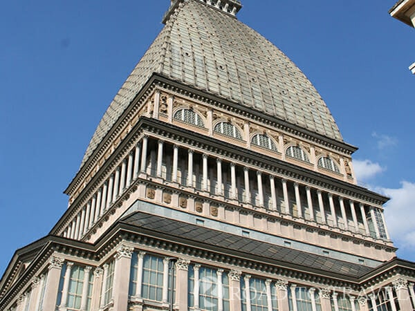 La Mole Antonelliana The Mole Antonelliana is a building of monumental proportions with its 168m (550 feet) of height,<br/> it could be considered the symbol of Turin. Since 2000 La Mole houses the National Museum of Cinema.